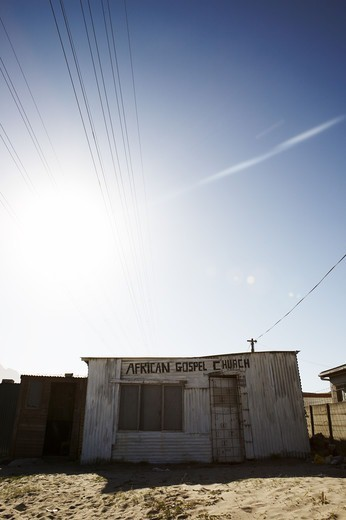 Stock Photo: 4306R-22773 A gospel church in a shed, South Africa.