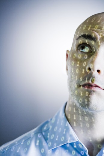 Stock Photo: 4306R-23166 Close-up of a man with digital numbers reflected on his face.