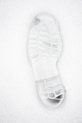 Stock Photo: 4306R-23282 The mark of a shoe in the snow, Sweden.