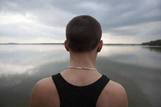 Stock Photo: 4306R-23634 Boy looking at the horizon, Sweden.