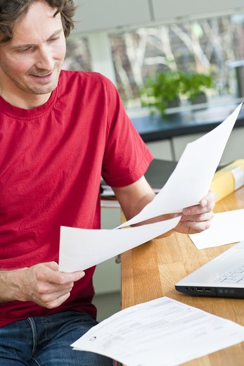 Mid section of man working from home : Stock Photo