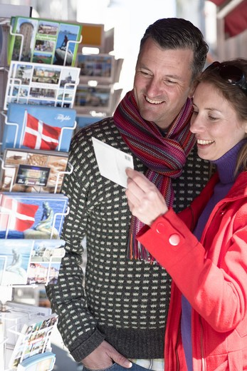Stock Photo: 4306R-23906 Couple buying postcards from outdoor stall