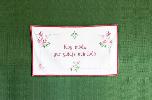 Stock Photo: 4306R-24457 Embroidered message on a wall hanging, Sweden.