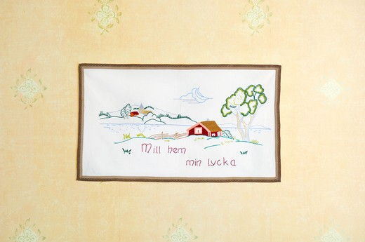 Stock Photo: 4306R-24479 Embroidered message on a wall hanging, Sweden.