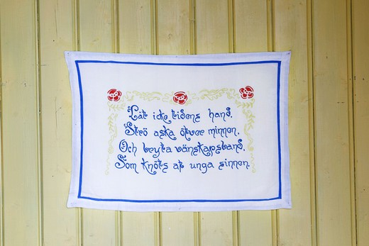 Stock Photo: 4306R-24482 Embroidered message on a wall hanging, Sweden.