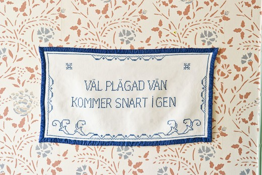 Embroidered message on a wall hanging, Sweden. : Stock Photo