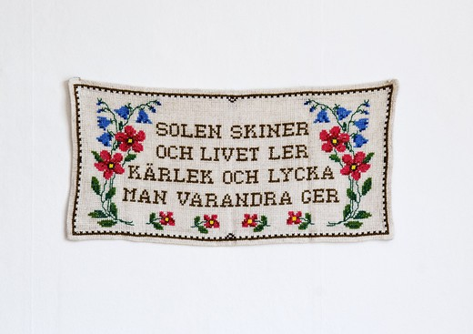 Stock Photo: 4306R-24517 Embroidered message on a wall hanging, Sweden.