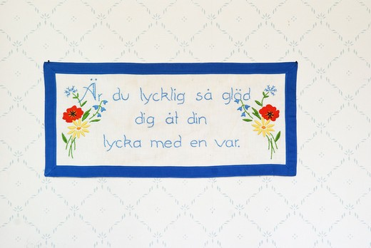 Stock Photo: 4306R-24523 Embroidered message on a wall hanging, Sweden.