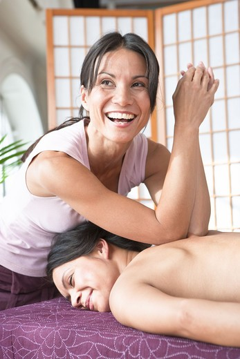Women smiling during spa massage : Stock Photo