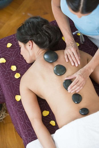 Stock Photo: 4306R-24907 Woman having lastone therapy at health spa