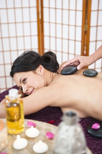 Stock Photo: 4306R-24916 Woman having lastone therapy at health spa