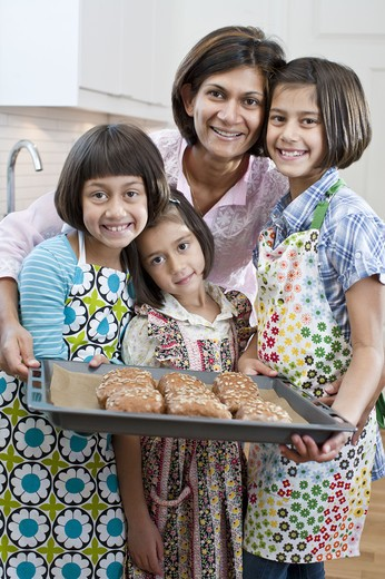 Portrait of mother with three daughters with freshly made rolls : Stock Photo