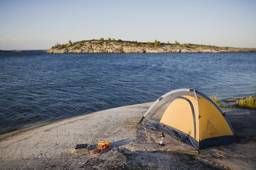 Stock Photo: 4306R-25155 Tent on beach by sea