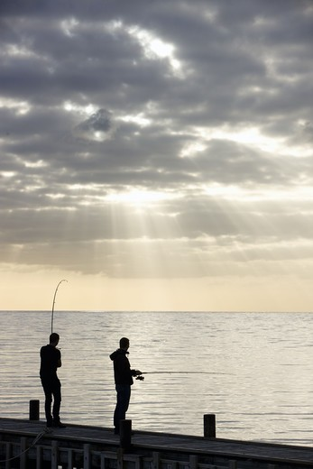Two men fishing from jetty : Stock Photo