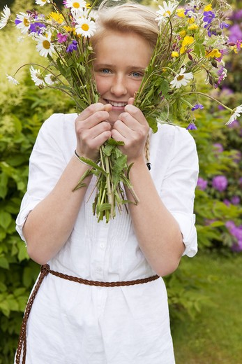 Portrait of teenage girl with bunch of flowers : Stock Photo