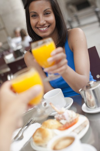 Couple toasting over breakfast at outdoor cafe : Stock Photo