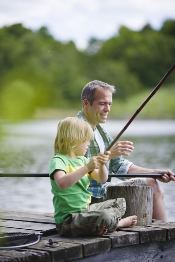 Stock Photo: 4306R-25559 Father and son fishing