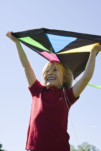 Portrait of boy  holding kite : Stock Photo