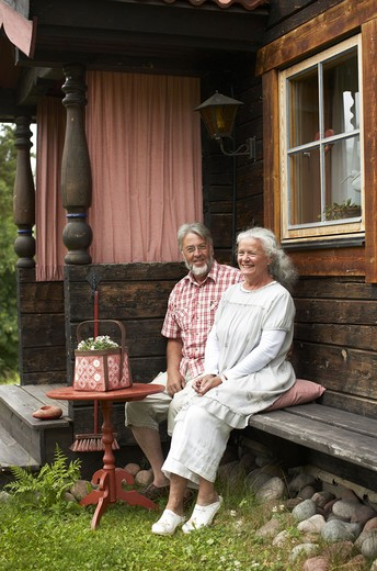 Stock Photo: 4306R-25652 Senior couple sitting in backyard