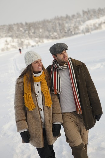 Stock Photo: 4306R-25825 Mid adult couple and walking in winter landscape