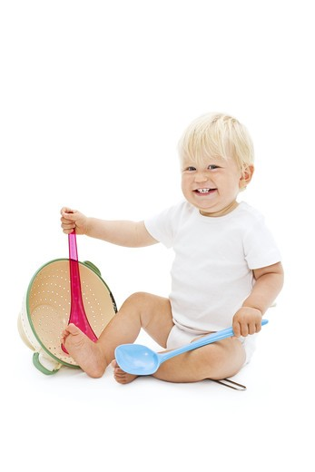 Stock Photo: 4306R-25869 Studio shot of baby boy playing with ladle
