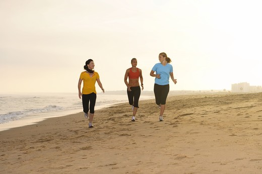 Stock Photo: 4306R-26014 Women jogging on beach