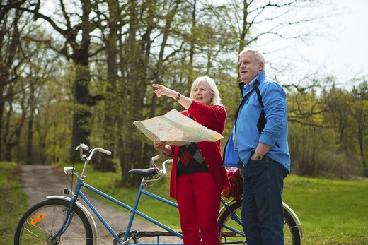 Senior couple with tandem bicycle : Stock Photo
