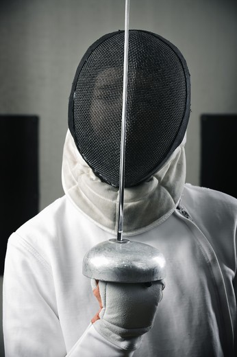 Stock Photo: 4306R-26258 Portrait of fencer wearing face guard