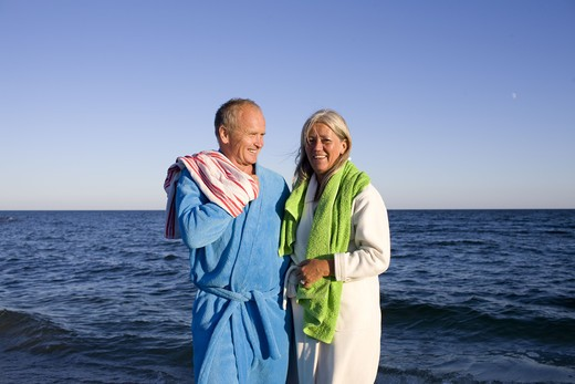 Stock Photo: 4306R-26747 Mature couple on beach