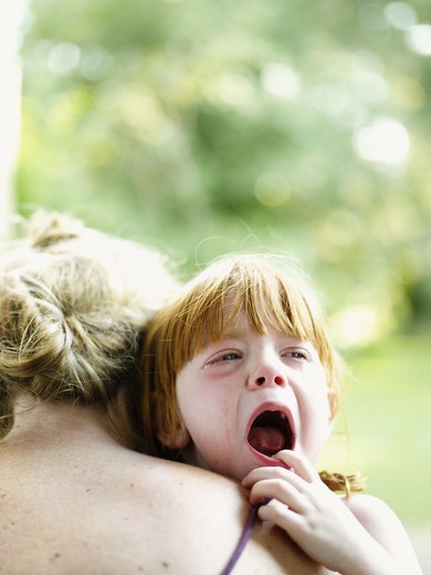 Stock Photo: 4306R-26858 Mother consoling crying daughter