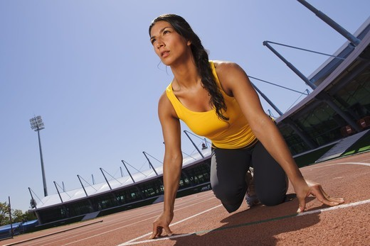 Stock Photo: 4306R-26917 Mid adult woman exercising on stadium