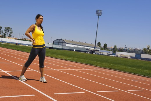 Stock Photo: 4306R-26922 Mid adult woman exercising on stadium