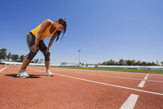Stock Photo: 4306R-26923 Mid adult woman exercising on stadium