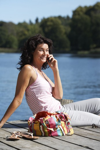Stock Photo: 4306R-27341 A  woman using a mobile phone, Sweden.