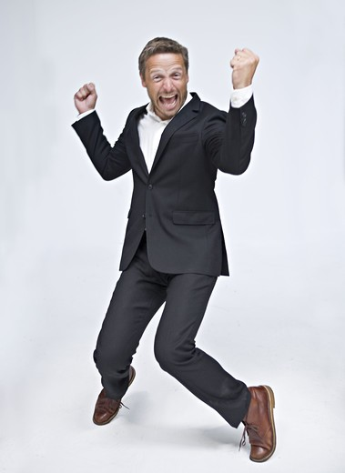 Stock Photo: 4306R-27642 Businessman dancing and screaming
