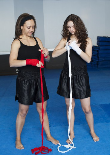 Stock Photo: 4306R-27964 Two women getting ready for kickboxing