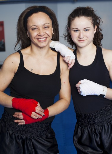 Stock Photo: 4306R-27965 Two women getting ready for kickboxing