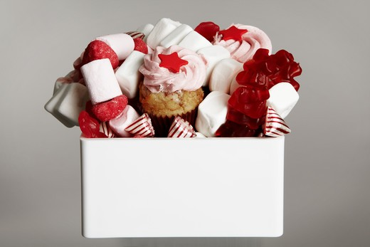 Stock Photo: 4306R-28097 Various confectionary in bow, close-up
