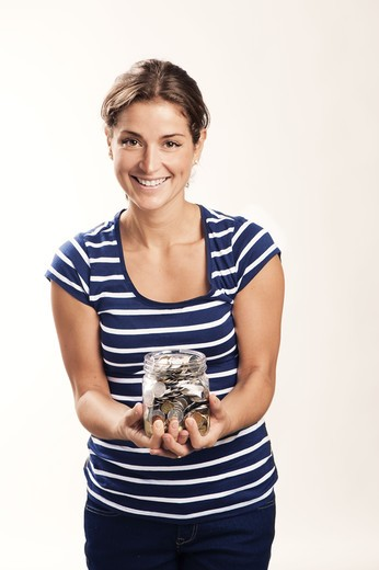 Stock Photo: 4306R-28181 A woman with a jar filled with coins
