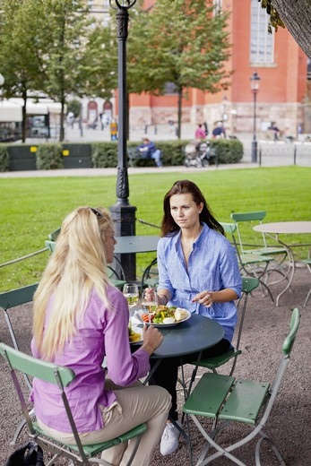 Stock Photo: 4306R-28381 Two women sitting at outdoor cafe