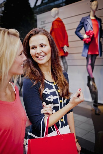 Stock Photo: 4306R-28383 Two women window shopping