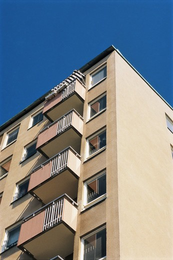 Stock Photo: 4306R-6625 Low angle view of multi storey building against blue sky