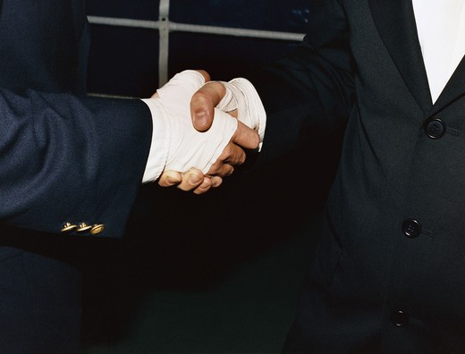 Stock Photo: 4306R-6692 Two people wearing bandages shaking hands