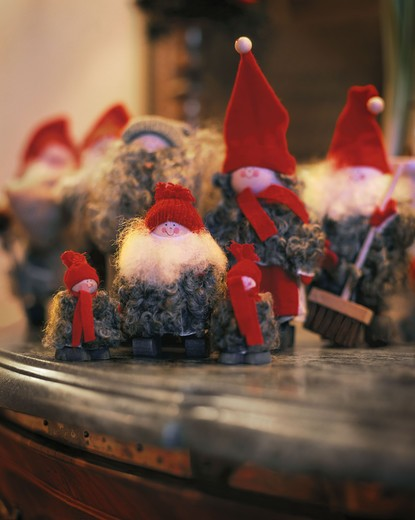 Santa Claus figurines on top of shelf : Stock Photo
