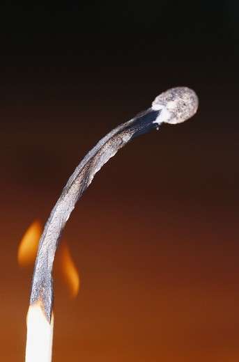 Stock Photo: 4306R-7113 Close-up of flaming match stick against black background