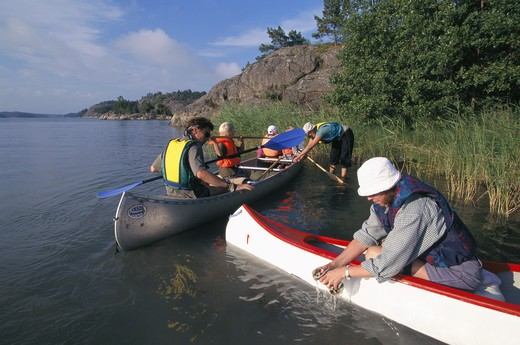 Stock Photo: 4306R-7211 Family canoeing in river