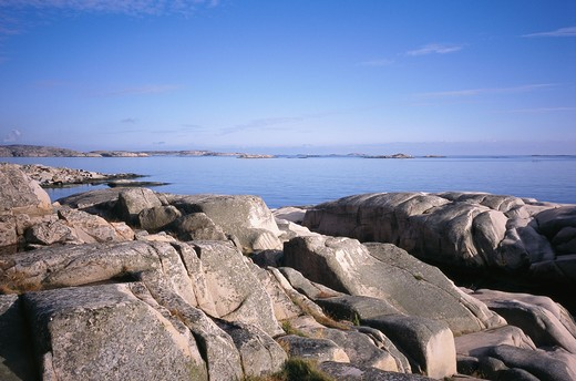Stock Photo: 4306R-7872 Large rocks with sea and sky in background