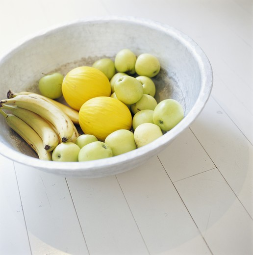 Stock Photo: 4306R-7903 Green apples, melons and bananas in bowl