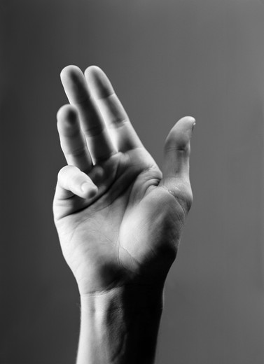 Stock Photo: 4306R-8107 Human hand gesturing against grey background