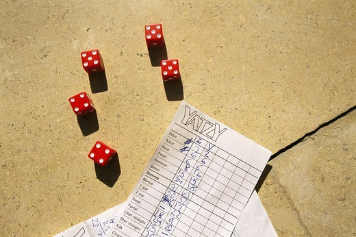 Stock Photo: 4306R-8354 Red dices with yatzy score sheet